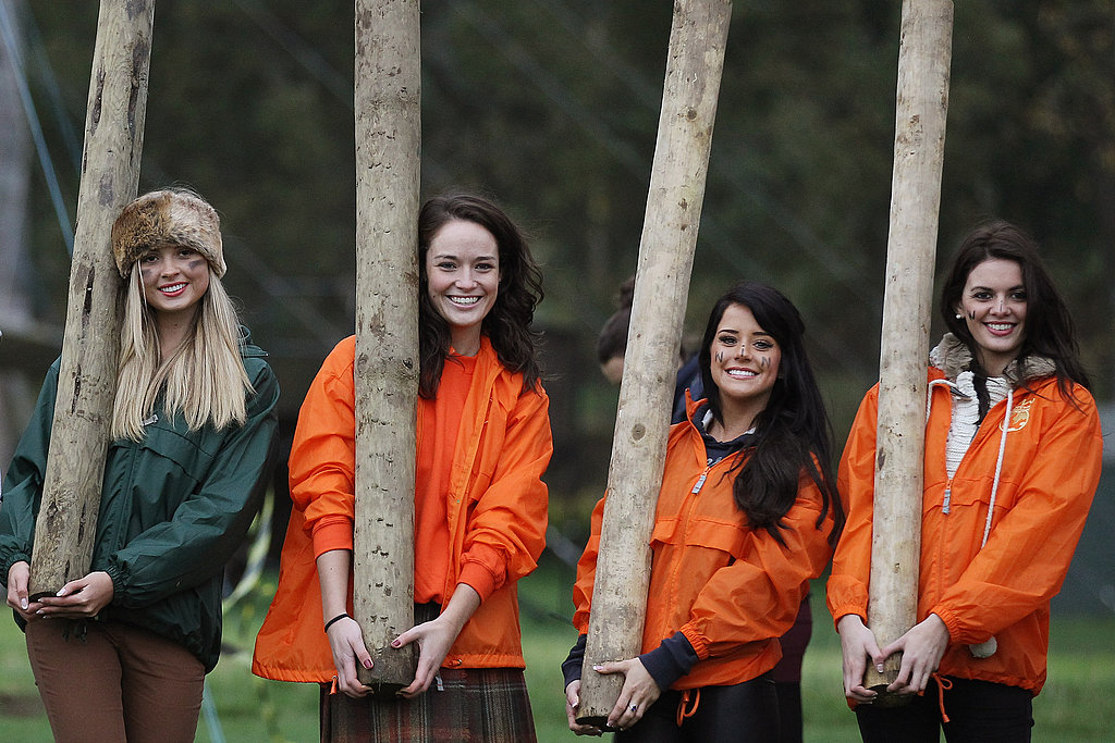 Miss England, Miss Scotland, Miss Wales, and Miss Northern Ireland get ready for the caber toss.