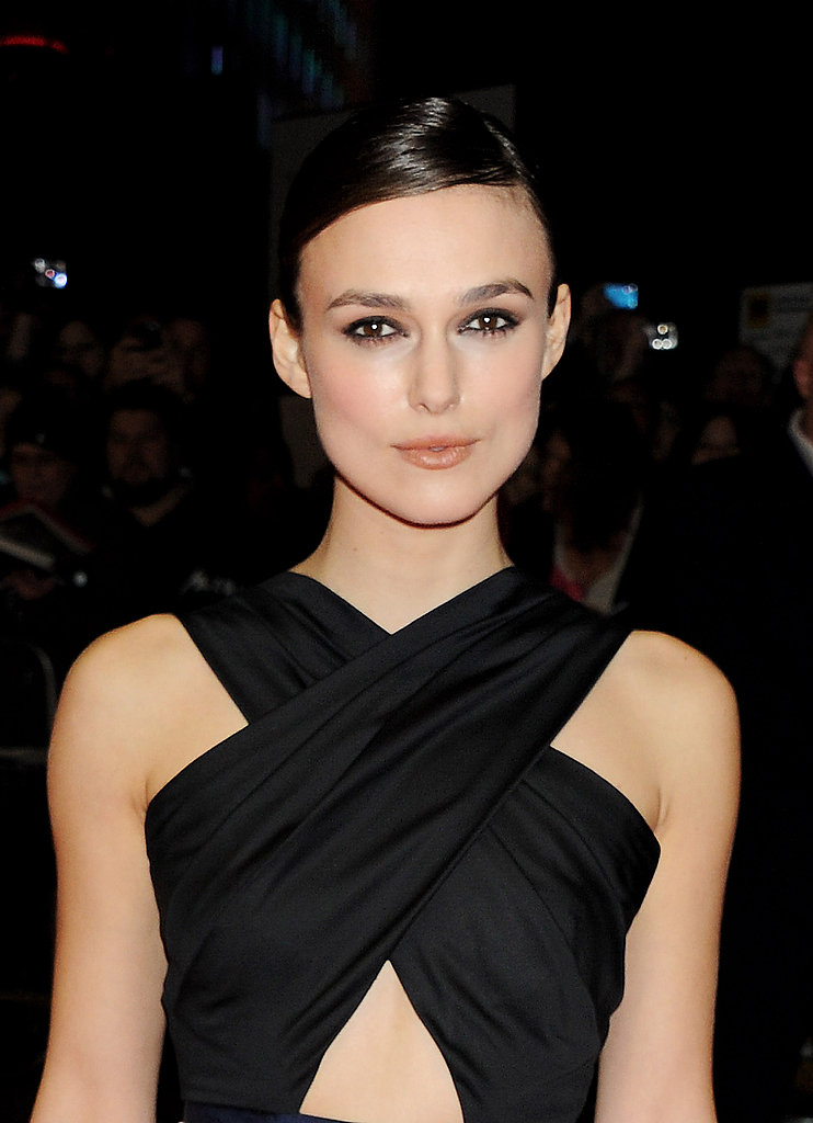 Keira Knightley wore a belly-baring dress to the premiere of A Dangerous Method in London.