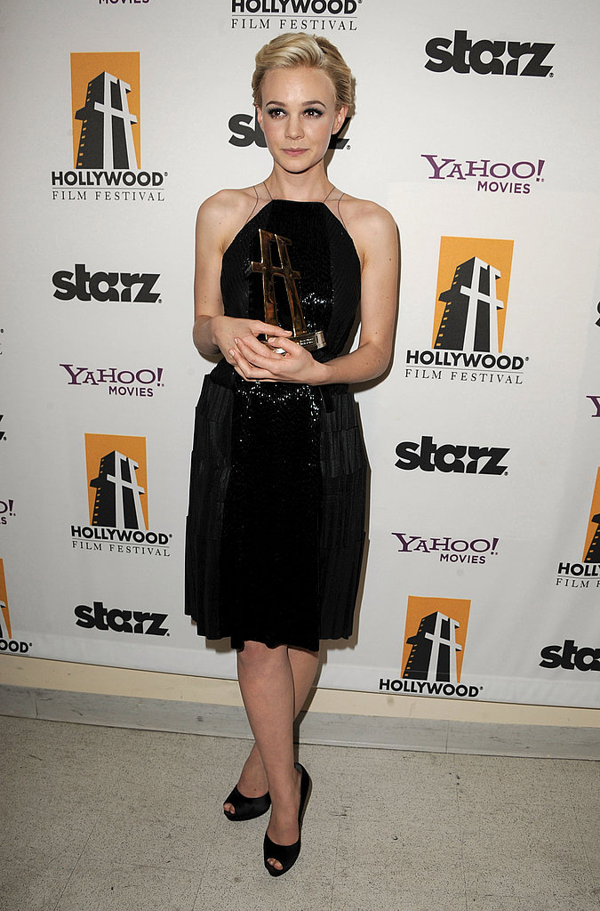 Carey Mulligan cradled her Hollywood Supporting Actress award.