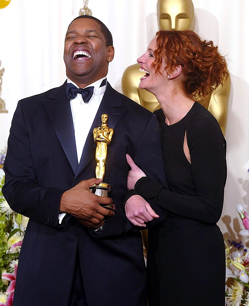 Julia Roberts got a laugh out of Denzel Washington after he won an Oscar for Best Actor at the 2002 Academy Awards.