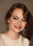 Emma Stone gave a crimson smile backstage at the 2011 Hollywood Film Awards.