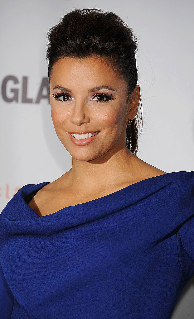 Eva Longoria in a royal blue dress.