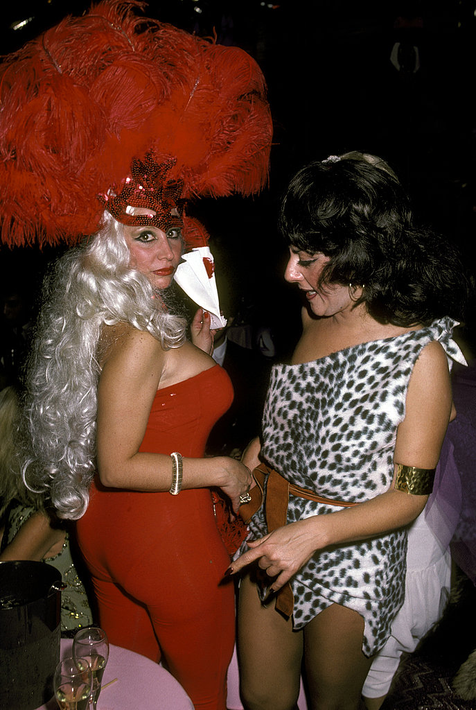 Two ladies don big and bold costumes at Régine's Halloween party in 1981.