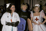 Martha Stewart is almost unrecognizable as a surfer flanked between funny ladies Rosie O'Donnell and Bette Midler at the Halloween Ball for New York Restoration Project in 1998.