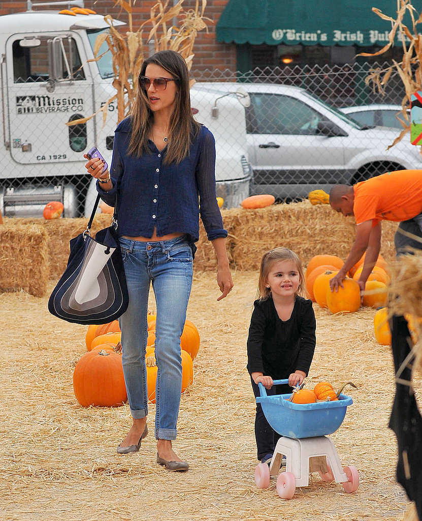Alessandra Ambrosio walked with Anja Mazur, who pushed their pumpkins.