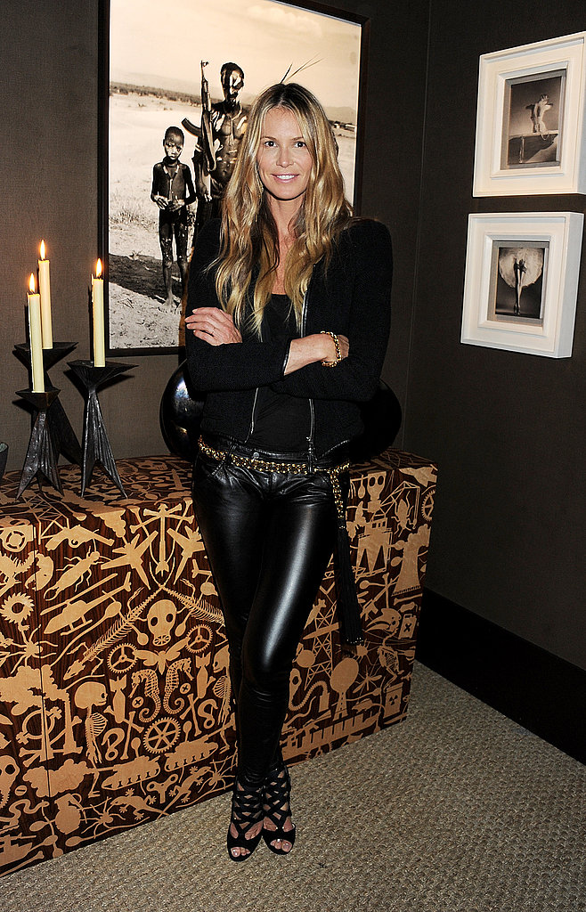 Elle Macpherson toughens up a casual-cool look with studs and leather in all the right places — just a touch on her shoes, slick pants, and a gold belt tie it all together.