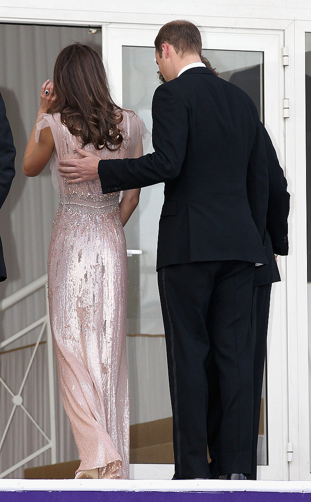 The duke couldn't keep his hand off a sparkling duchess at the 10th annual ARK gala dinner at Kensington Palace in 2011.