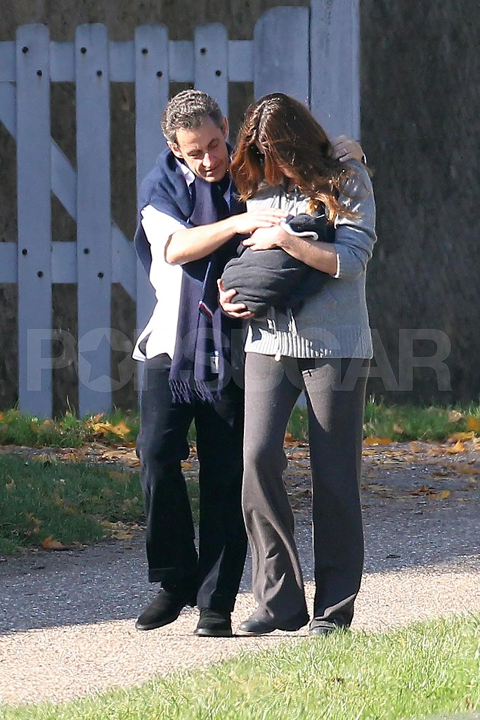 Carla Bruni and Nicolas Sarkozy tenderly looked at their newborn Giulia Sarkozy.