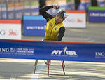 Masazumi Soejima of Japan Finishes First in the Wheelchair Division