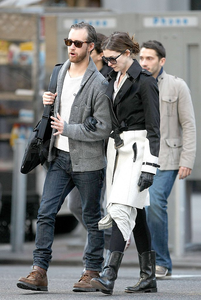 Anne Hathaway put her arm in Adam Shulman's.