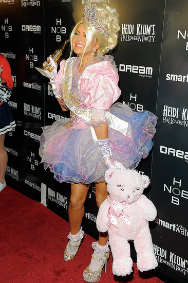 Fergie dressed as a toddler in tiara.