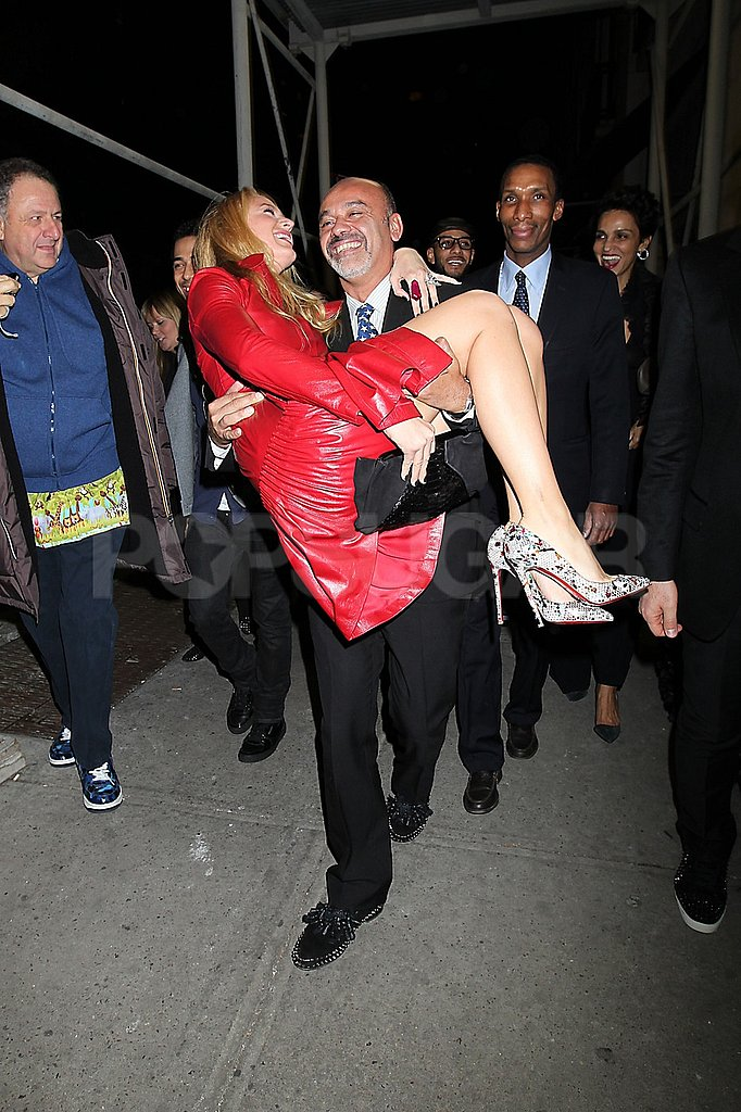 Christian Louboutin swept Blake Lively up in his arms.