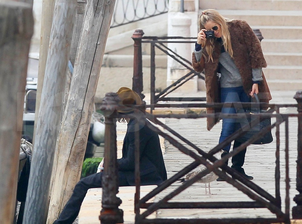 Sienna Miller took artful shots of the scene in Venice.