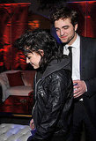 Robert Pattinson placed his hand on Kristen Stewart's back at the New Moon afterparty in 2009.