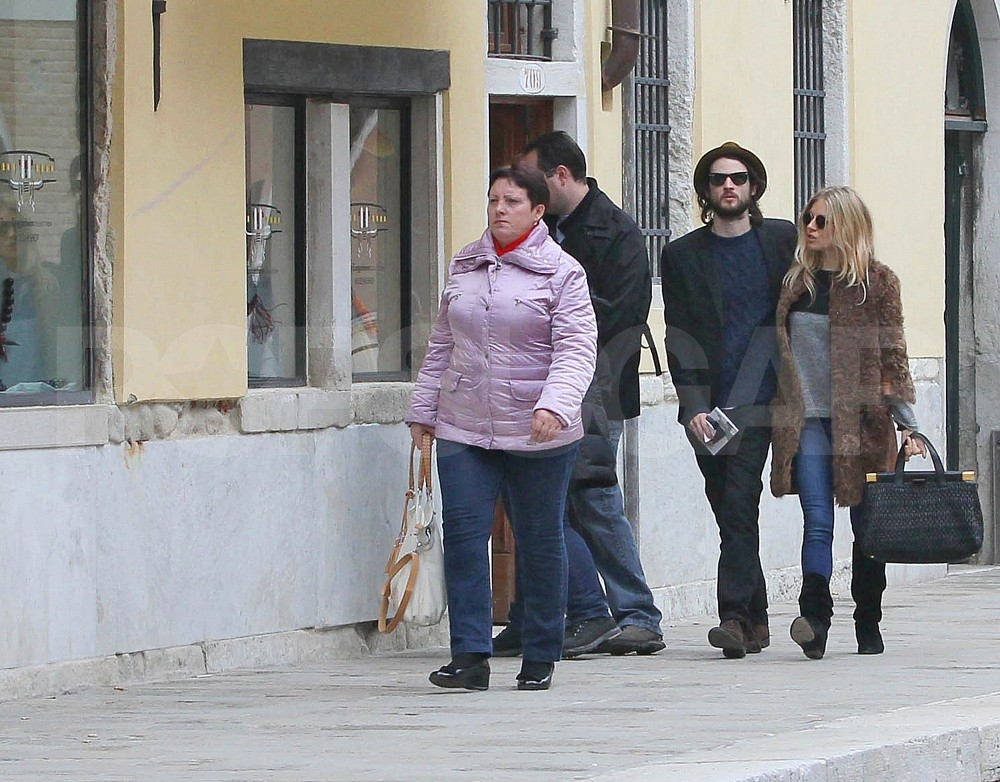Sienna Miller and Tom Sturridge walked hand in hand.