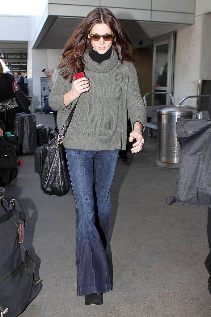 Ashley Greene traveled in flared jeans.