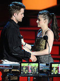 Robert Pattinson and Kristen Stewart got cozy while staging a kiss at the 2010 MTV Movie Awards.