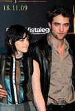 Robert Pattinson had his hand around Kristen Stewart's waist during a fan event in Spain in 2009.