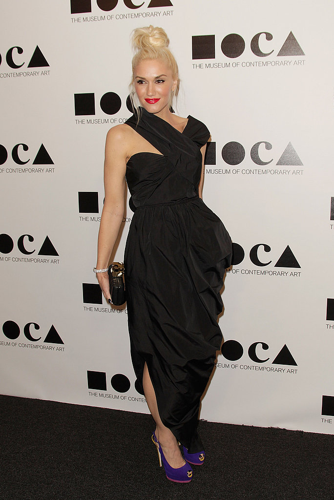 Gwen Stefani paired a black dress with pops of color on her lips and shoes.