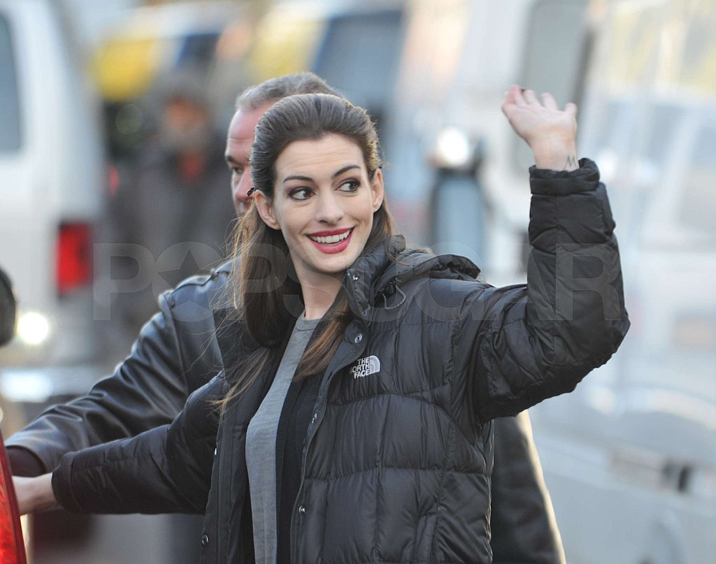 Anne Hathaway wore a North Face parka before shooting.