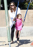 Jennifer Garner pushing Seraphina Affleck on the swings.