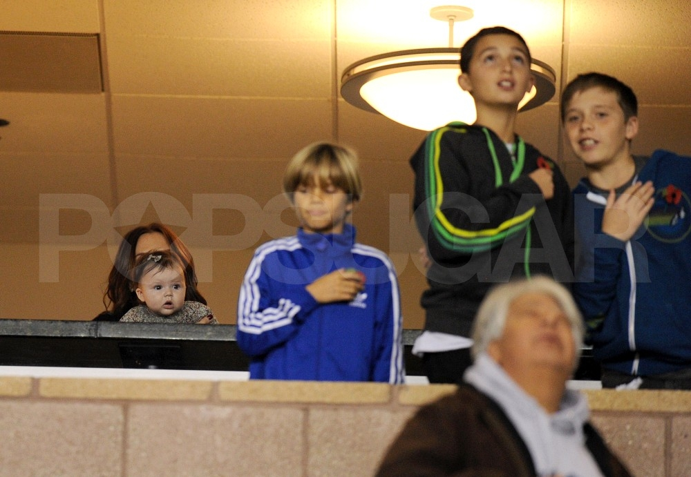 Victoria Beckham and Harper Beckham snuggled in the stands while Romeo, Brooklyn, and their friend stood for the national anthem.