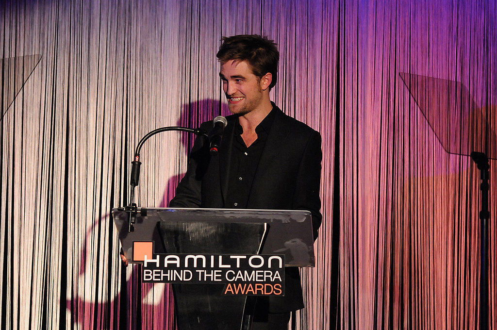 Robert Pattinson laughed while giving a speech in LA.