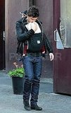 Orlando Bloom carrying Flynn.