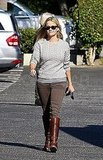 Reese Witherspoon paired a gray sweater with brown cords.