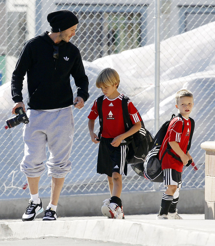 David Beckham walked Romeo and Cruz to their soccer game in LA.