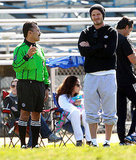 David Beckham talked to the ref at his sons' soccer game.