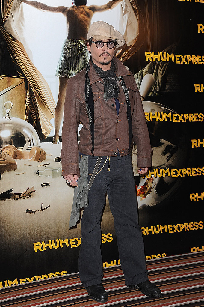 Johnny Depp arrived in his trademark glasses and accessorized with a newsboy cap.