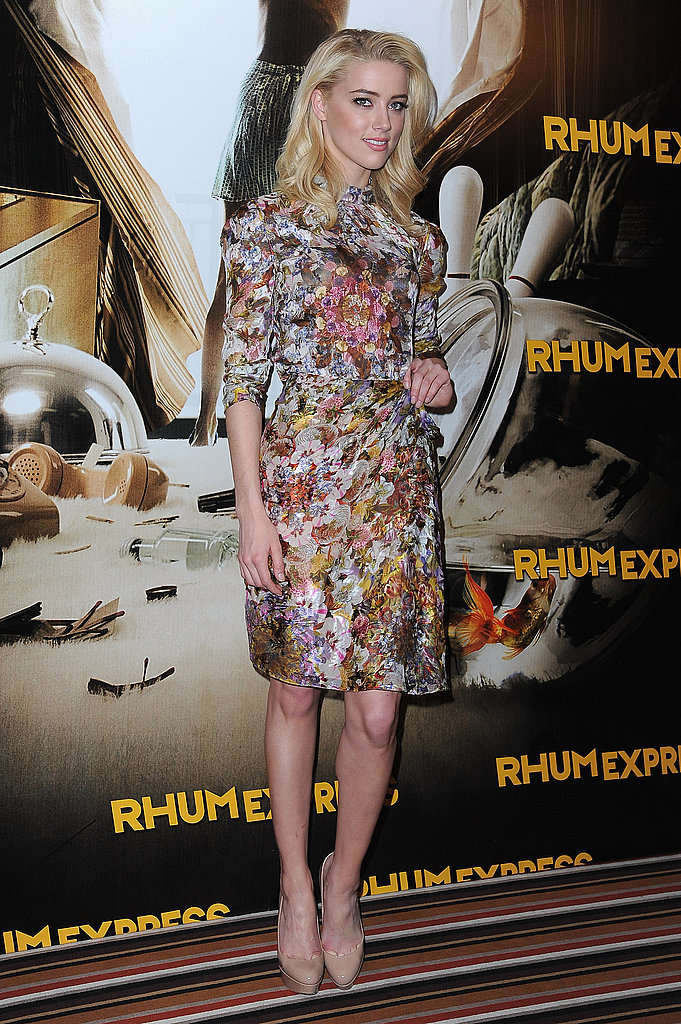Amber Heard wore a floral dress to the photocall.