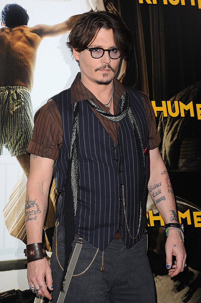 Johnny Depp in a vest and scarf in Paris.