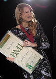 "Taylor Swift held her BMI Country award for ""Back to December."""
