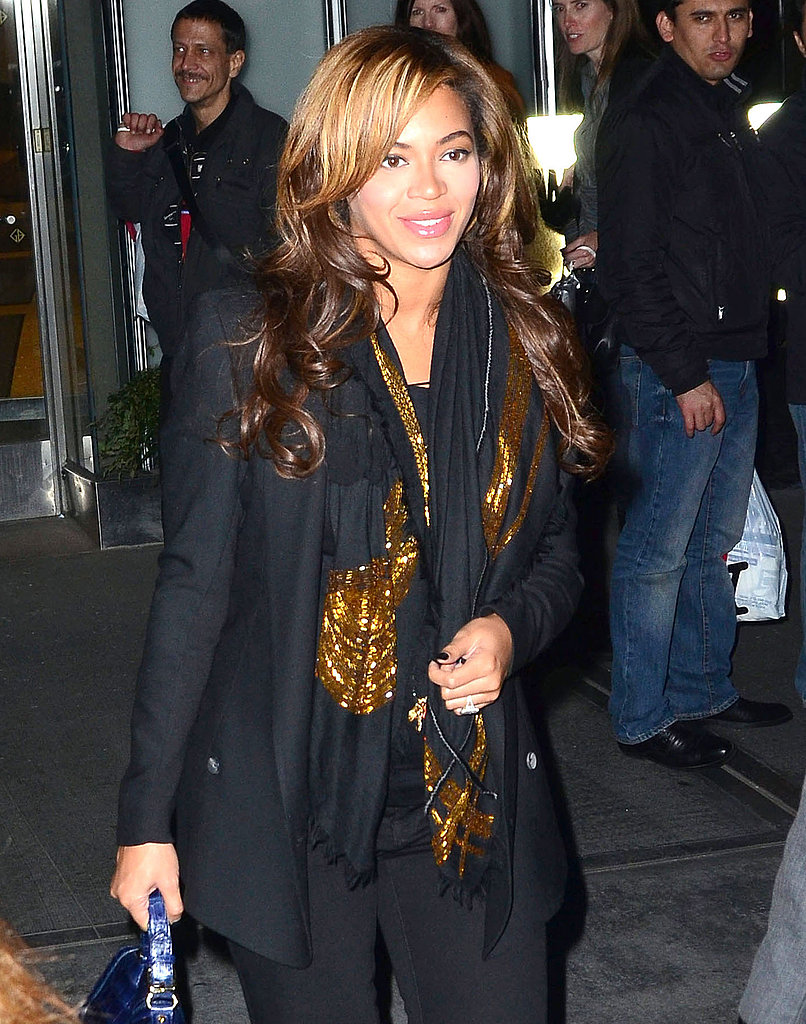 Beyoncé Knowles in a black and gold scarf.