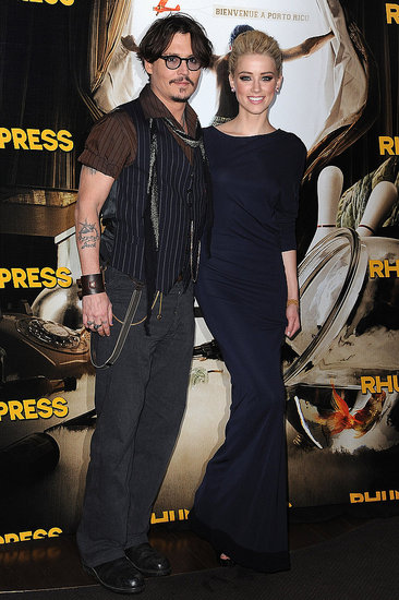 Johnny and Amber Color-Coordinate For Their Parisian Premiere