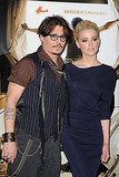 Johnny Depp and Amber Heard kept close at The Rum Diary premiere.