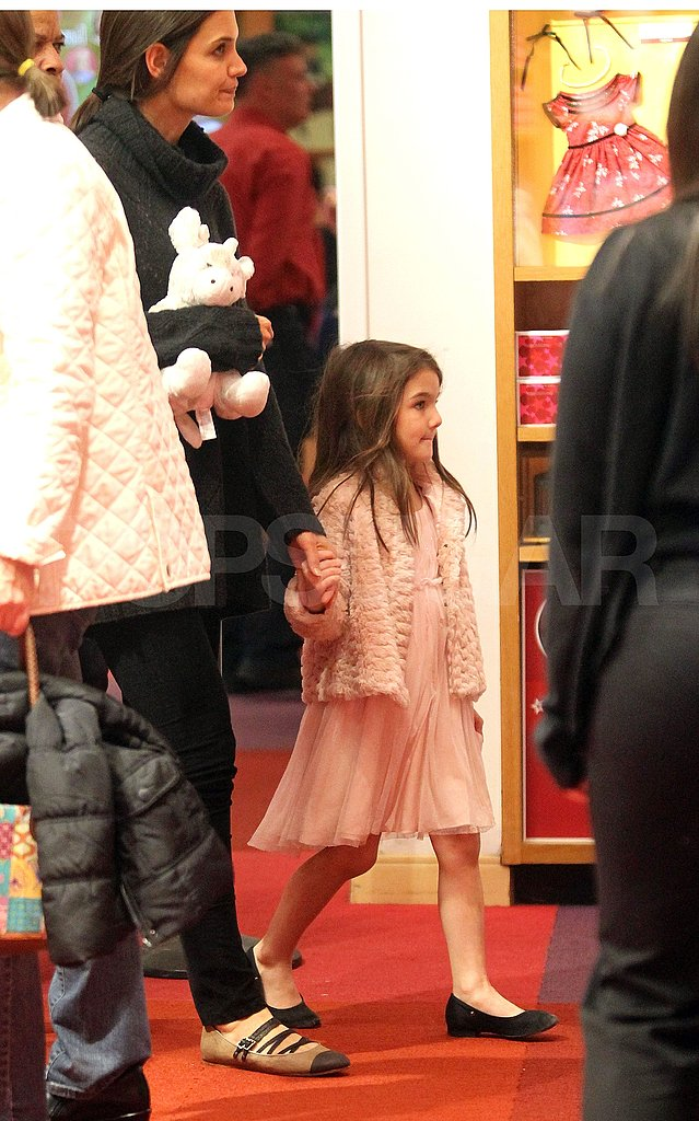 Suri Cruise led Katie Holmes through a toy store.