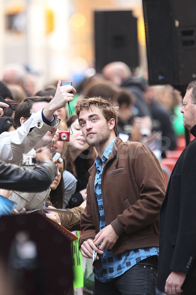 Robert Pattinson in a brown jacket.