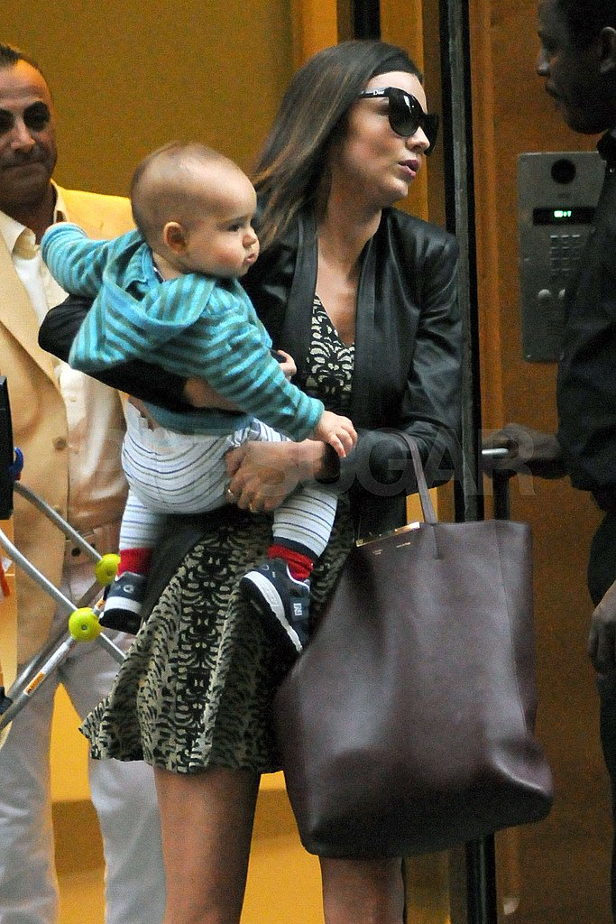 Miranda had her arms full with her bag and Flynn.