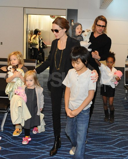 Angelina Jolie and Brad Pitt at the Tokyo airport with Knox, Zahara, Maddox, Vivienne, and Shiloh Jolie-Pitt.