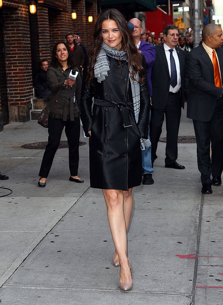 Katie Holmes wore a dark trench and short dress for her Late Show appearance.