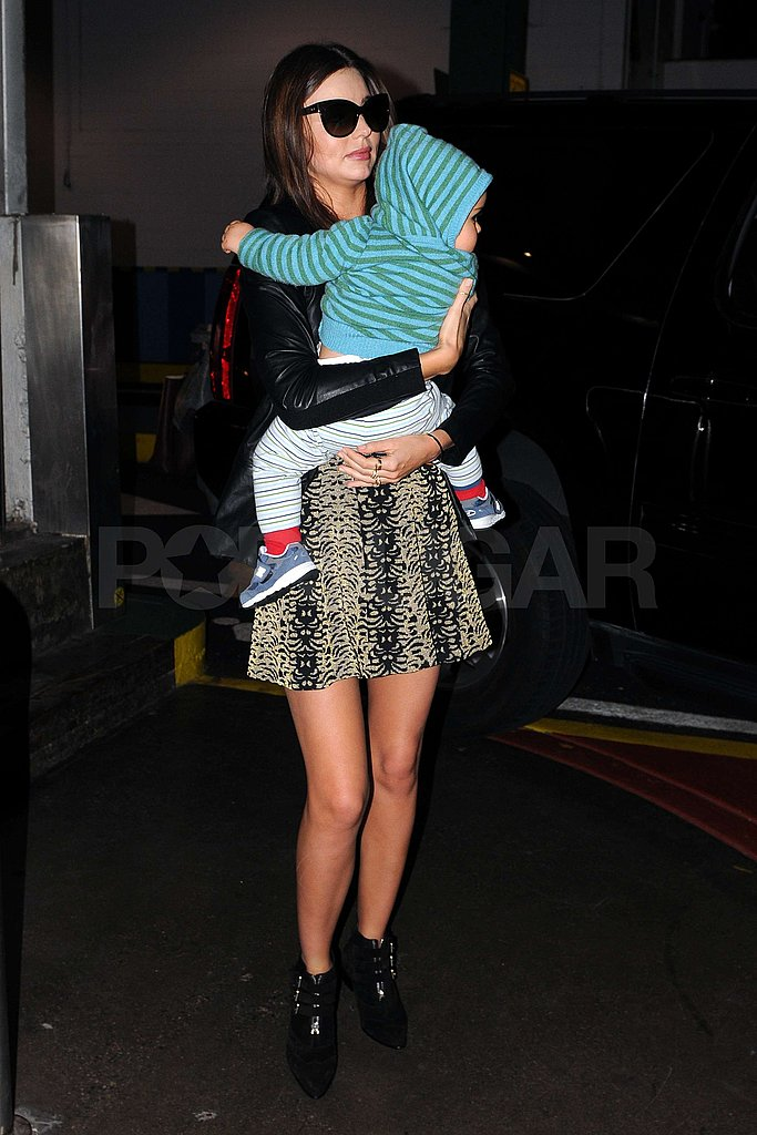 Miranda cuddled Flynn during their shopping day in NYC.