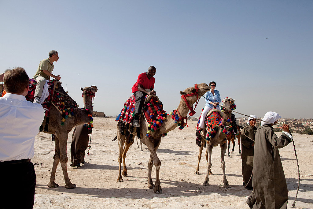 Then chief of staff Rahm Emanuel, Reggie Love, and senior advisor Valerie Jarrett take a ride on camels during a visit to Egypt in Summer 2009.