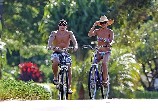 Shirtless Nick Lachey and bikini-clad Vanessa Minnillo kept their hot bodies in shape on bikes.