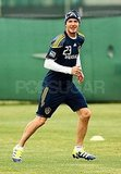David Beckham playing soccer.