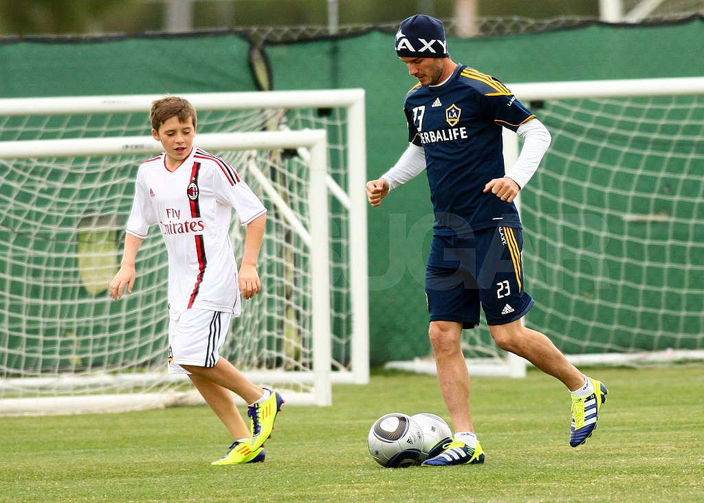 David and Brooklyn Beckham playing soccer.