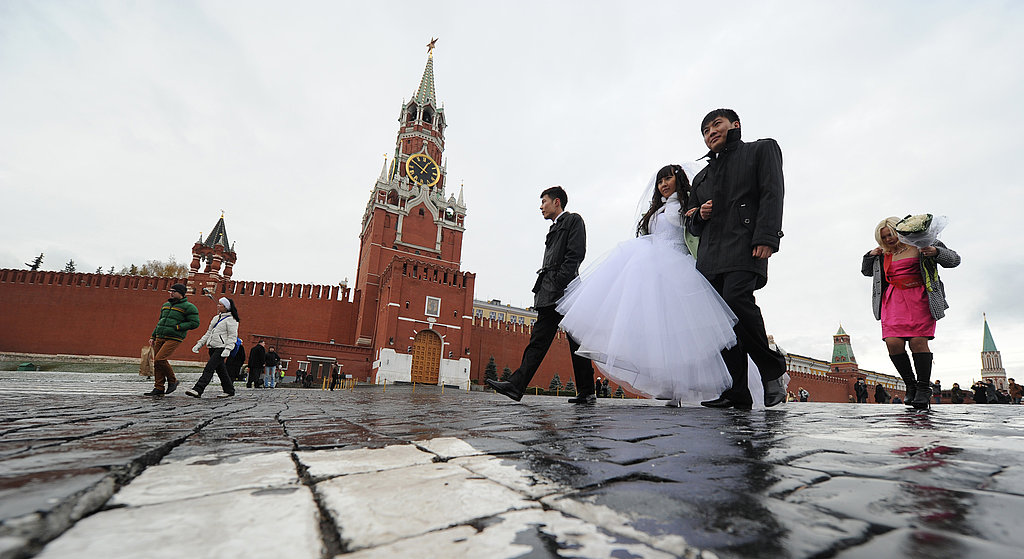 A newly-married couple walks at the Red Square in Moscow.