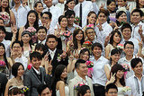 Newlyweds pose for photographs during a mass wedding ceremony at the Thean Hou temple in Malaysia.